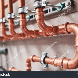 stock-photo-plumbing-service-copper-pipeline-of-a-heating-system-in-boiler-room-1614456811